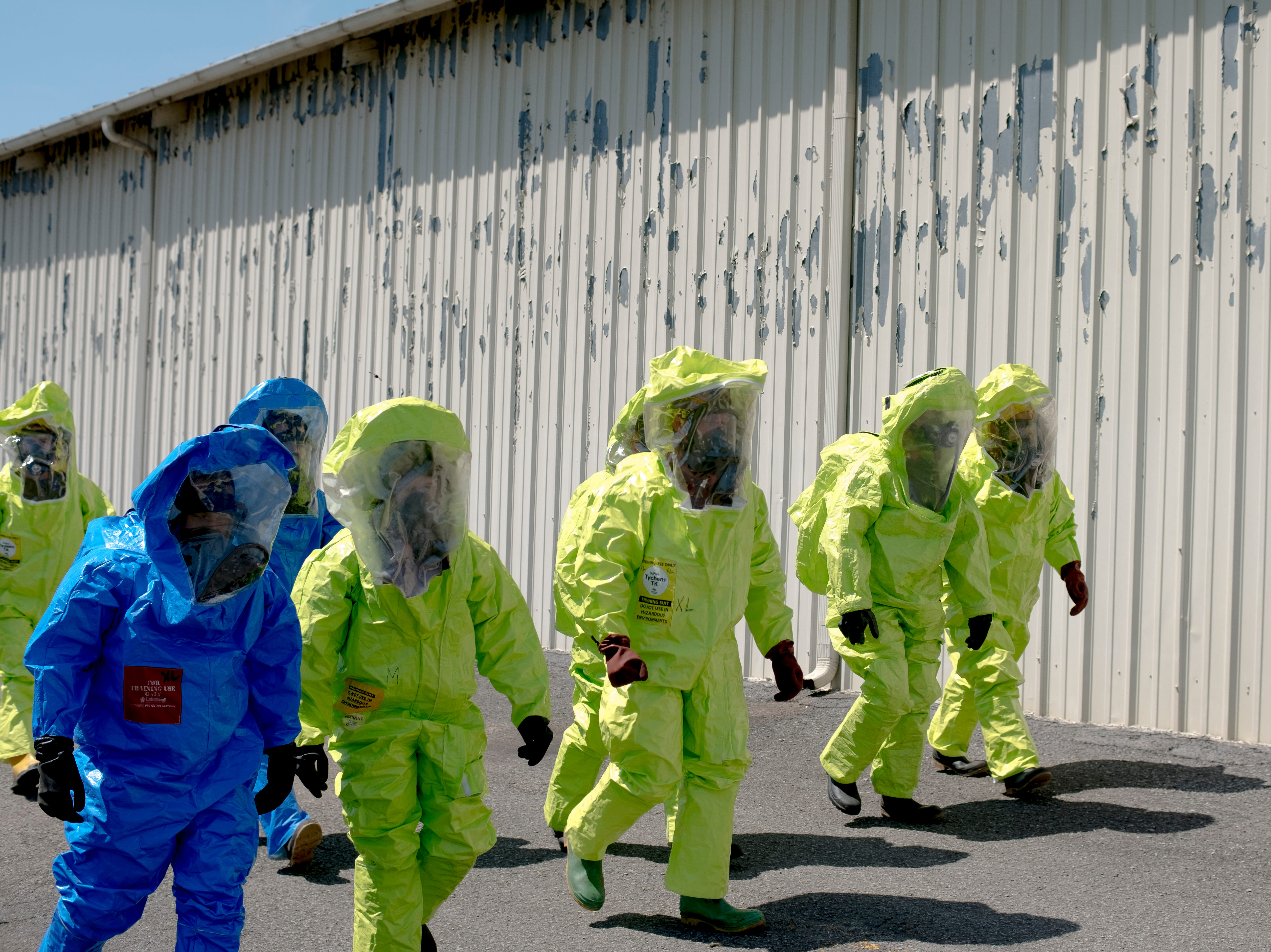 Students in a hazardous material technicians class at UT walk in Class A hazmat suits during a field training session near the UT Records Management building on Middlebrook Pike in Knoxville, Tennessee on Wednesday, April 3, 2019. The students, most of them with military backgrounds, were training to work for a company that remediates underground bombs and hazardous material in brown fields. Their training requires OSHA's 29 CFR 1910.120 certification, which private sector emergency responders obtain after successfully undergoing hazardous material response training, said Charles Gluck, a safety consultant with UT and the leader of the training exercise.