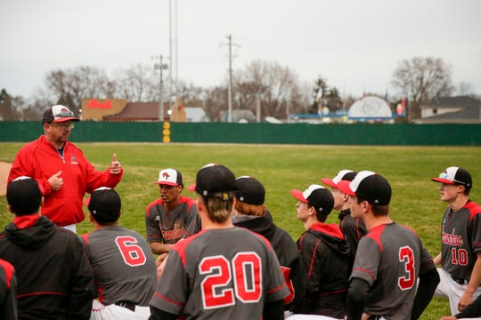 Lafayette Jefferson head coach Scott McTagertt talks with the team after defeating Logansport, 9-6, Wednesday, April 3, 2019, at Loeb Stadium in Lafayette.