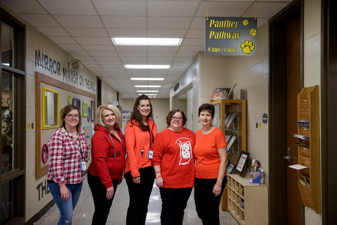 From left, Carrie Hovermale, Jennifer Leahy, Kelli Whitlock, Sarah Williams and Jackie Spitznagle pose for a photo in the hallways of Hershey Elementary, Thursday, April 4, 2019, in Lafayette. Teachers are calling attention to the need for more public education funding by walk-ins before school hours on Wednesday, April 10, 2019.