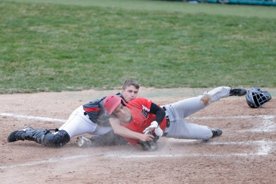 Lafayette Jeff catcher Brady Preston tags out Logansport's Drake McLochlin on a double steal attempt in the fifth inning of the Bronchos' 9-6 win on Wednesday at Loeb Stadium.