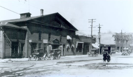 Shambaugh's Garage at Sixth and Alabama streets, shown here in 1924, held Buick and Ford agencies. It was built in 1903 as a multipurpose coliseum and acquired by Shambaugh in 1909.