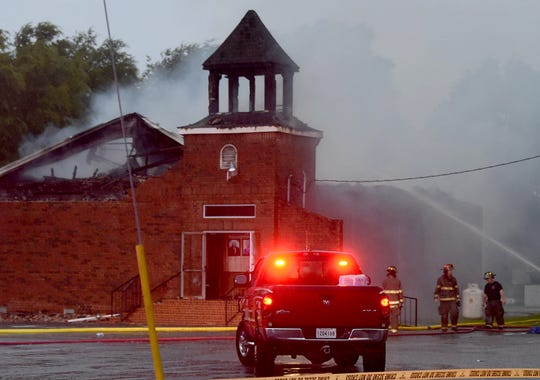 Firefighters at the scene of a fire that destroyed Mt. Pleasant Baptist Chiurch located on La. 182 about three miles south of Opelousas.