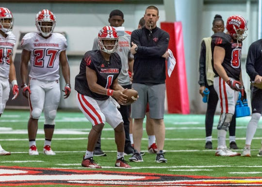 UL coach Billy Napier watches quarterback Levi Lewis work during a spring practice last week.