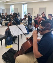 The Spartan Strings, led by Comeaux High teacher Molly Goforth, are competing in a music festival at Walt Disney World April 6. They get in a final after-school rehearsal Wednesday before the trip.