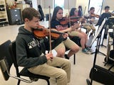 Comeaux High orchestra heads to Disney World