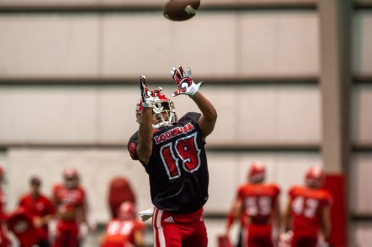 UL's Eric Garror goes up for the ball during a spring practice last week.
