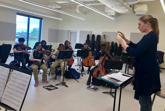 Molly Goforth leads Comeaux High's orchestra, the Spartan Strings, which is competing in a music festival at Walt Disney World April 6. They get in a final after-school rehearsal Wednesday before the trip.