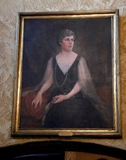 A painting of Mabel Wagnalls Jones hangs above the entrance to the Wagnalls Memorial auditorium in Lithopolis.
