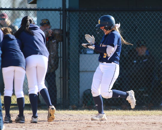 Brooke Cowan cruises home to a celebration after her two-run homer for Hartland in a 4-2 victory at Howell on Wednesday, April 3, 2019.