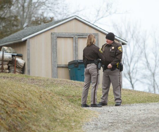 Livingston County Sheriffs Deputy Anthony Clayton speaks with a fellow deputy at the scene of an investigation into an explosive device on Owosso Road in Conway Township Thursday, April 4, 2019.