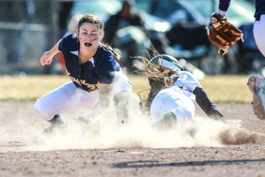 Hartland shortstop Delaney Robeson tags out Howell's Anna Hanson on a steal attempt on Wednesday, April 3, 2019.