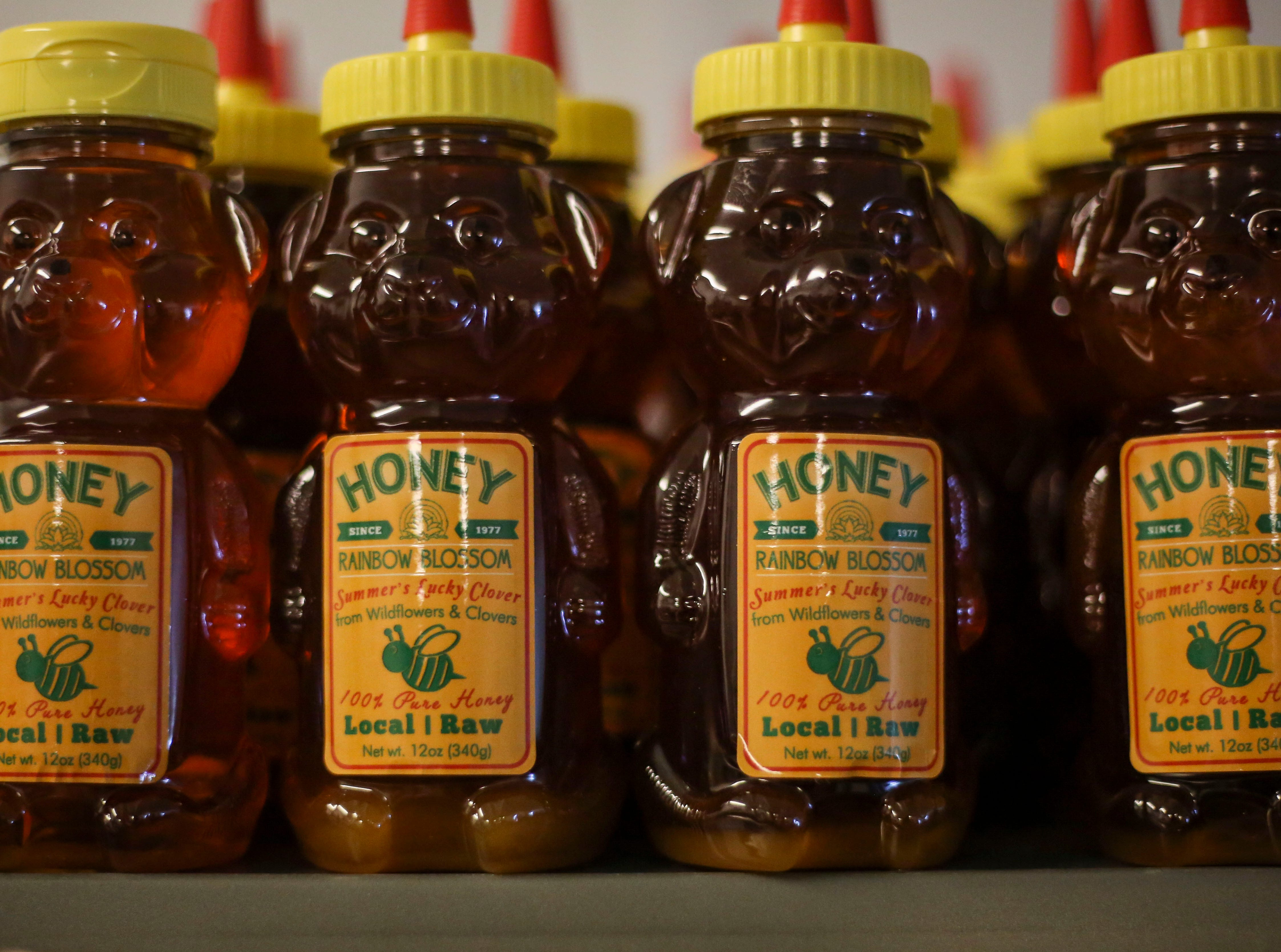 Honey bear jars sit in the warehouse of Hosey Honey, a family owned honey company, in Midway, Ky. on Wednesday, April 3, 2019. The Hosey's Queen's Triple Crown honey is used in the sweetener in the $1,000 Woodford Reserve Kentucky Derby mint julep.