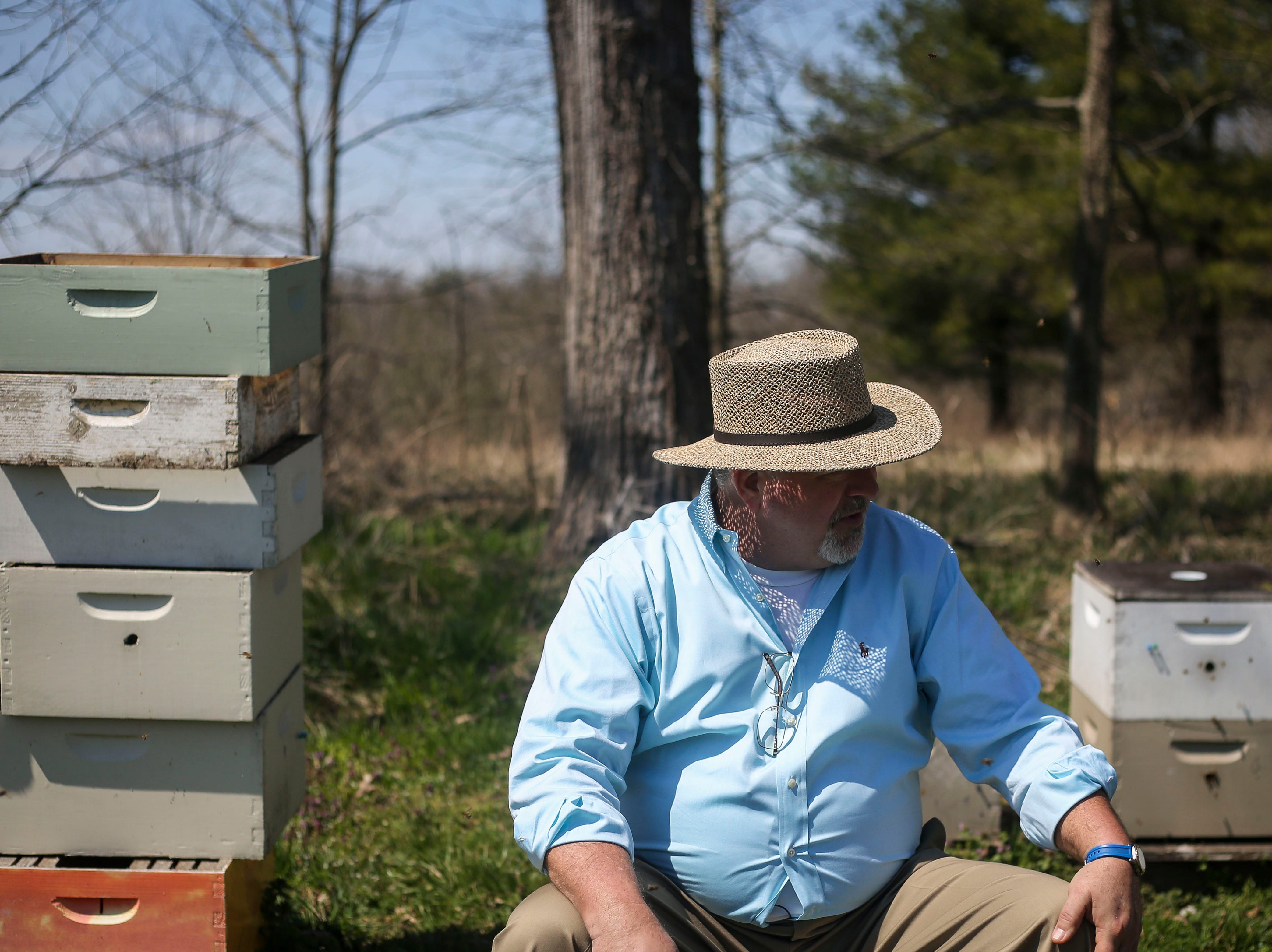 Richard Hosey, owner of Hosey Honey, a small family run honey company, sits for a portrait in his bee yard in Midway, Ky. on Wednesday, April 3, 2019. Their Hosey's Queen's Triple Crown honey is used in the sweetener in the $1,000 Woodford Reserve Kentucky Derby mint julep.