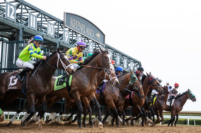 Horses leave the gate at the start of the fourth race at Keeneland on opening day. April 4, 2019.