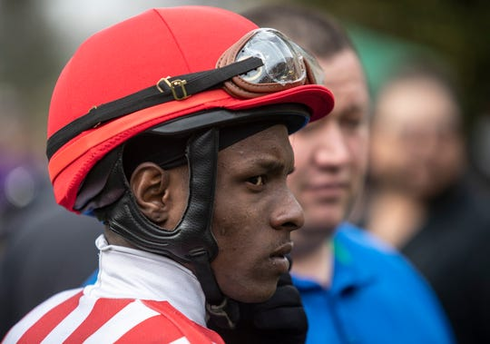 Jockey Euclyn Prentice Jr. waited to mount his horse, Bud's Bayonet for the fourth race at Keeneland, on opening day at the track. April 4, 2019.