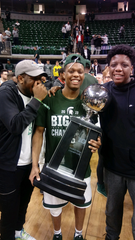Michigan State point guard Cassius Winston (center) celebrates after beating Michigan to win a share of the Big Ten title with his brothers Zach (left) and Khy (right).