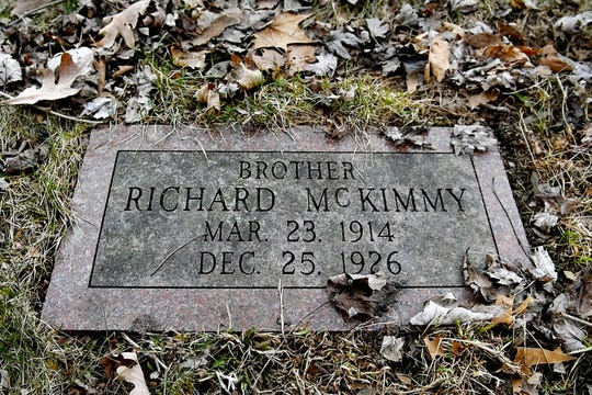 The grave of Richard McKimmy is the only grave that is marked in a section where 61 boys are buried at Mount Hope Cemetery photographed on Tuesday, April 2, 2019, in Lansing. All of boys died betweenÊ1856 to 1933 at the former Boys Training School in Lansing. A renewed effort is underway to place markers on their graves.