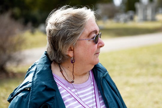 Loretta Stanaway, president of Friends of Lansing's Historic Cemeteries, pauses while talking about the 60 boys that are buried in unmarked graves at Mount Hope Cemetery on Tuesday, April 2, 2019, in Lansing. Sixty-one boys that died between 1856 to 1933 at the former Boys Training School in Lansing are buried at the cemetery. Only one grave has a marker. A renewed effort is underway to place markers on their graves.