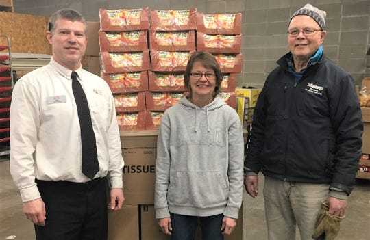 Fox's Piggly Wiggly gives approximately $500 in groceries to the Two Rivers Ecumenical Pantry. Pictured from left: Rob Ullman, store manager at Fox's Piggly Wiggly Two Rivers; Lynn Skarvan, TREP coordinator; and Paul Schmid, TREP driver.