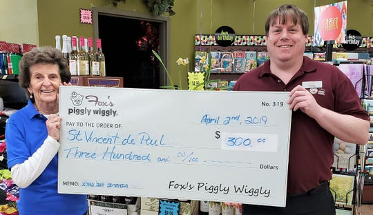 Fox's Piggly Wiggly gave $300 to Two Rivers' St. Vincent de Paul. Pictured from left: Shirley Andrews, board member of St. Vincent de Paul, and Brandon Schwake, grocery manager of Fox's Piggly Wiggly Two Rivers.