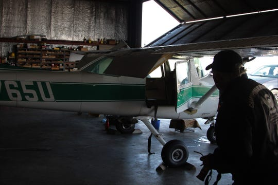 Bob Forsblom, with the Central Ohio Soaring Association, works on a Cessna 150 inside a hanger at the Marion Municipal Airport on Tuesday.