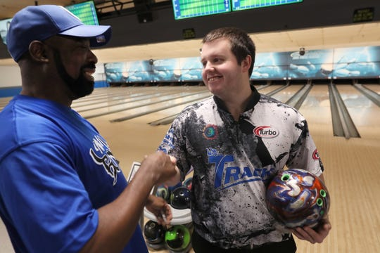 Mykel Holliman, right, is congratulated by fellow league bowler Perry Miller after taking second place at the USBC masters tournament in Las Vegas, a pro circuit bowling event. Holliman met with locals back in Memphis at Billy Hardwick's All-Star Lanes where he competes in league bowling, on Wednesday, April 3, 2019