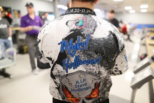 Mykel Holliman where a tribute to he late father Steve on the back of his bowling jersey at Billy Hardwick's All-Star Lanes, where he competes in league bowling, on Wednesday, April 3, 2019.