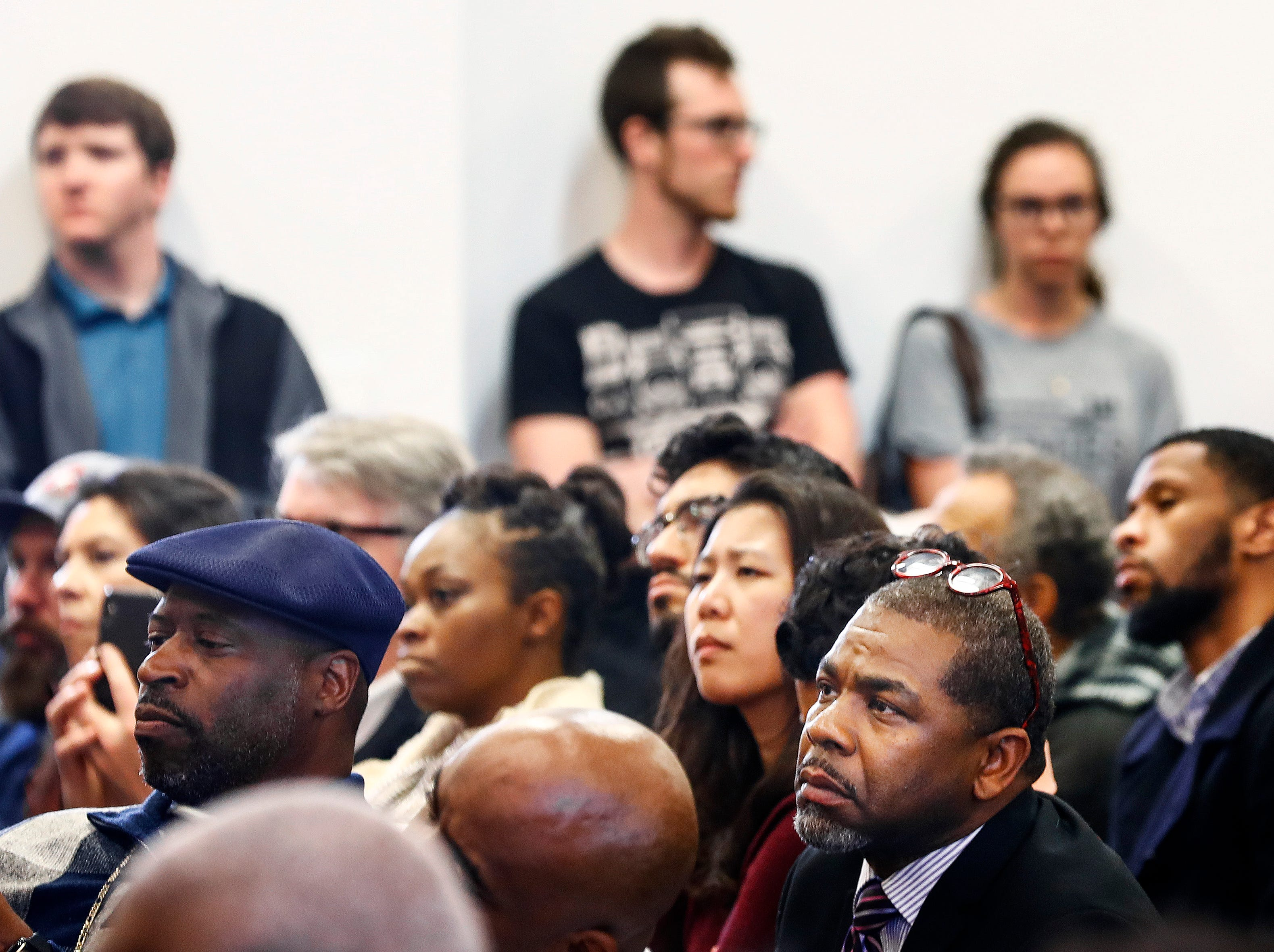 During a commemoration event at the National Civil Rights Museum on April 4, 2019, people reflect on the 51st anniversary of Dr. Martin Luther King, Jr.'s assassination.