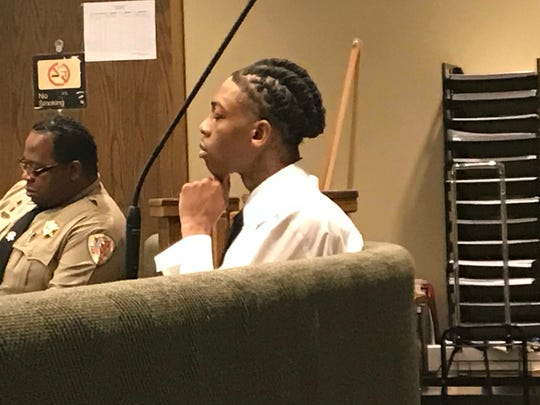 Kwasi Corbin listens to testimony during his first-degree murder trial. He's accused of killing Myneishia Johnson, 18, in 2016.