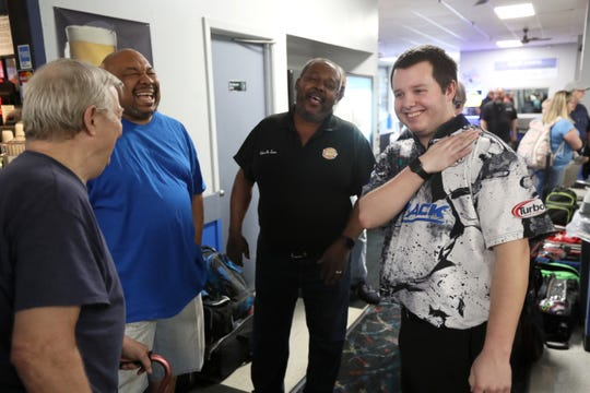 Mykel Holliman, right, chats with fellow local league players after returning home from his second place finsh at the USBC masters tournament in Las Vegas, a pro circuit bowling event. He's seen here at Billy Hardwick's All Star Lanes where he competes in league bowling, on Wednesday, April 3, 2019.