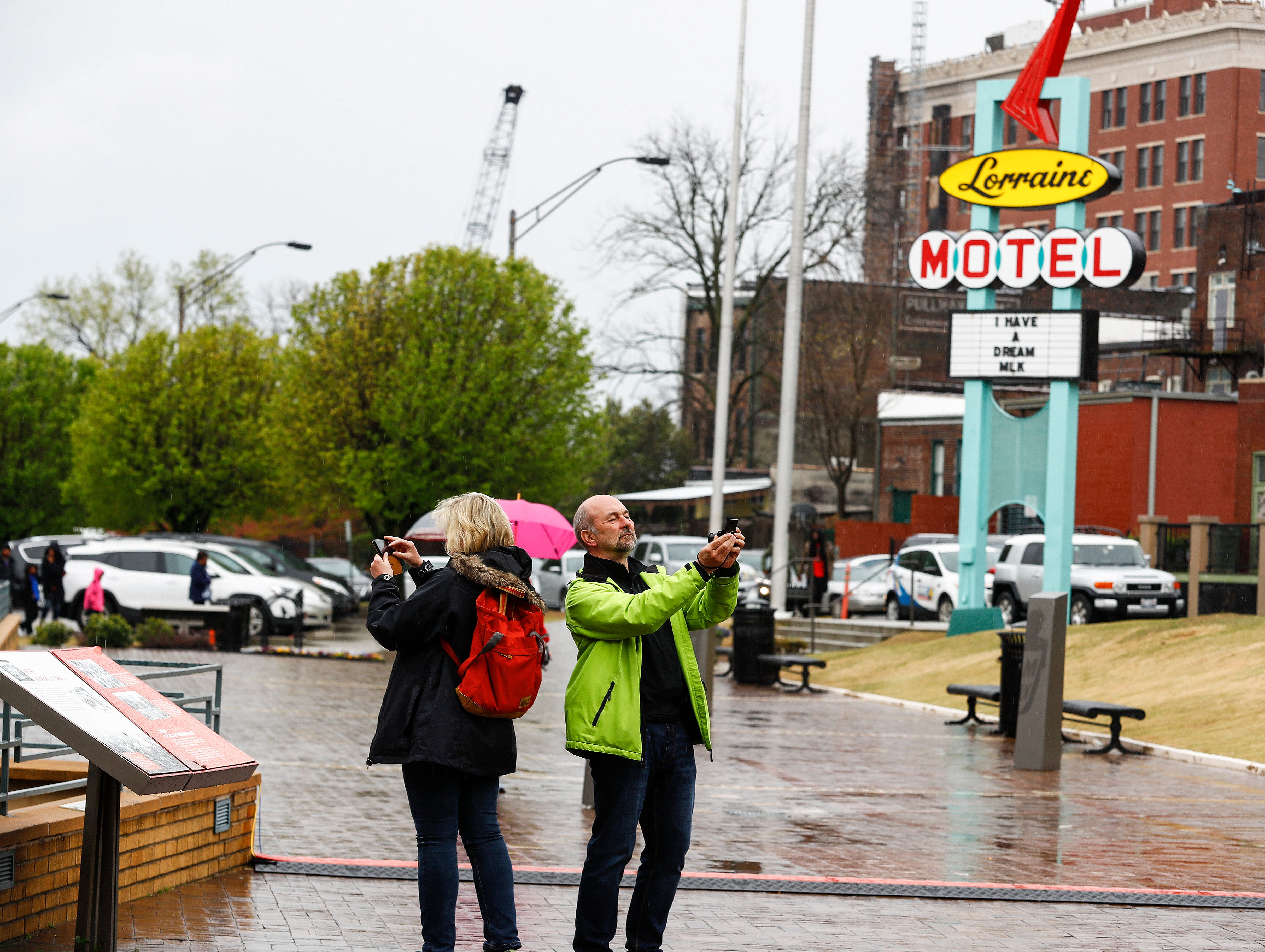 People brave the rain to attend a commemoration ceremony at the National Civil Rights Museum on April 4, 2019, on the 51st anniversary of Dr. Martin Luther King, Jr.'s assassination.