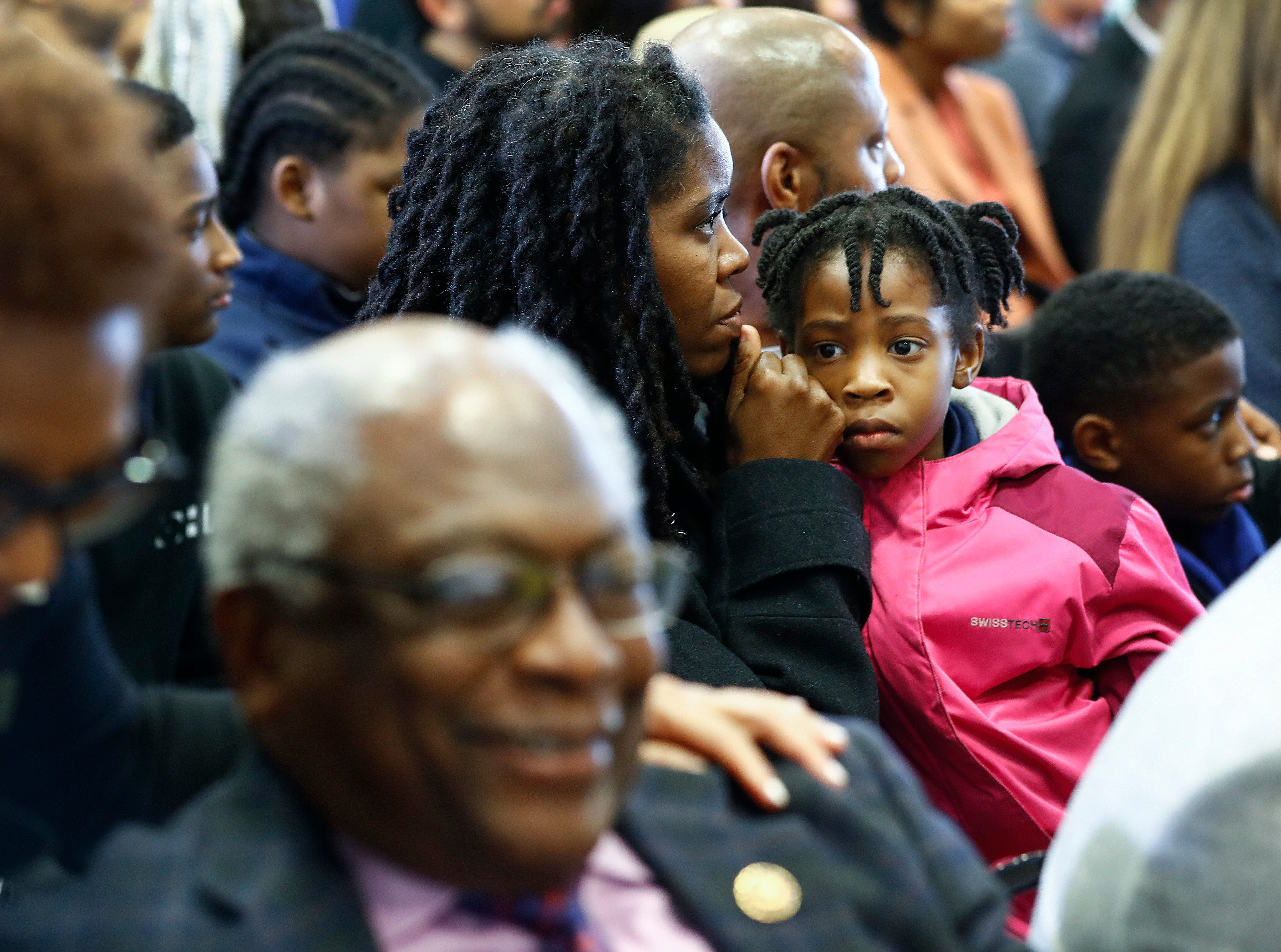 People reflect during a commemoration ceremony at the National Civil Rights Museum on April 4, 2019, on the 51st anniversary of Dr. Martin Luther King, Jr.'s assassination.