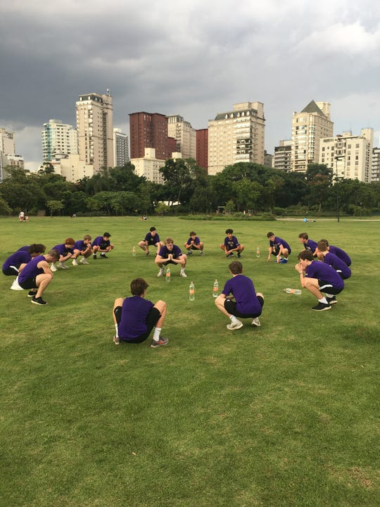 The Christian Brothers soccer team stretches after a training session in Sao Paulo, Brazil