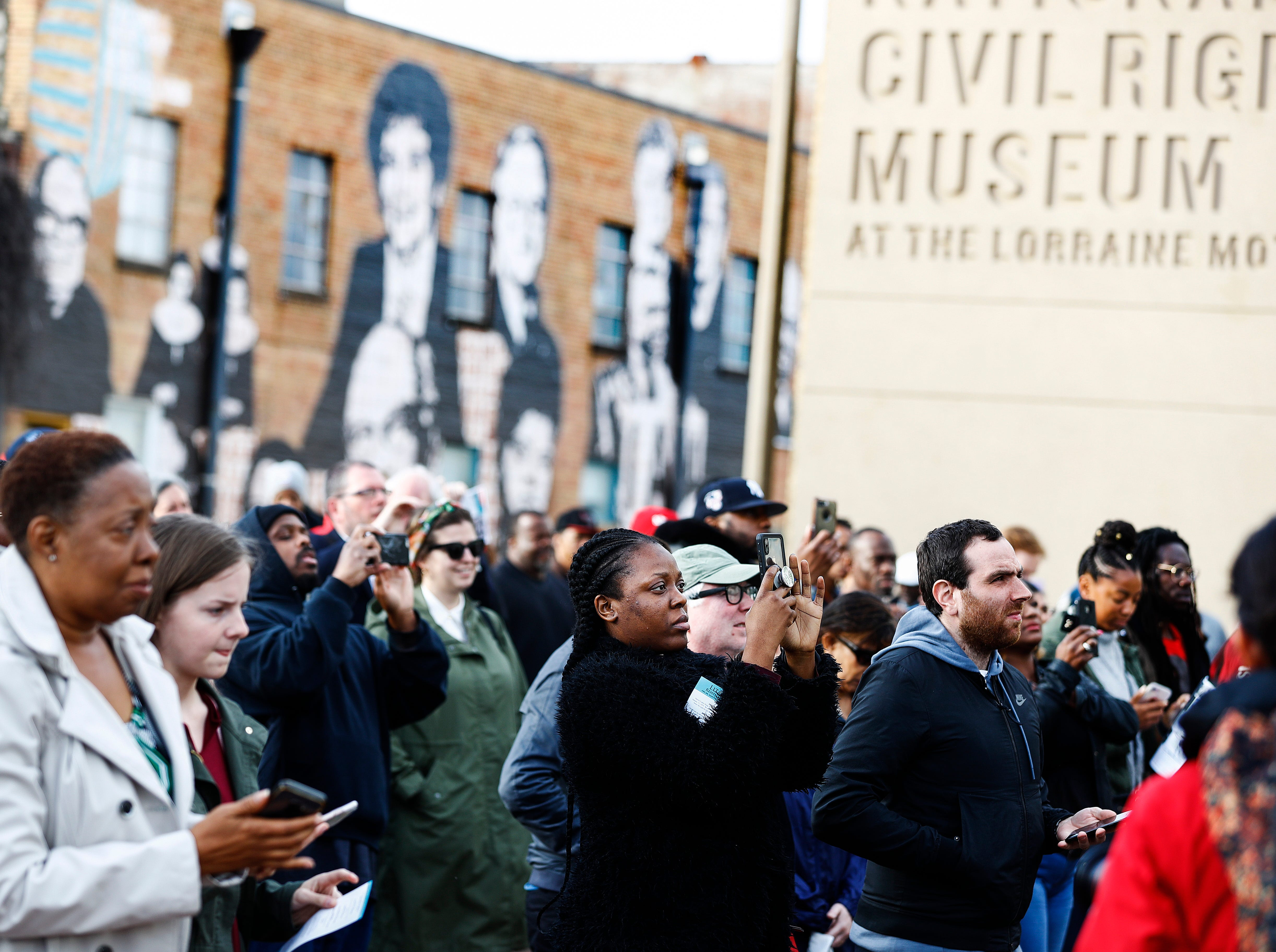 A crowd gathers as a wreath is placed in front of Room 306 at the National Civil Rights Museum April 4, 2019, during a commemoration ceremony on the 51st anniversary of Dr. Martin Luther King, Jr.'s assassination.