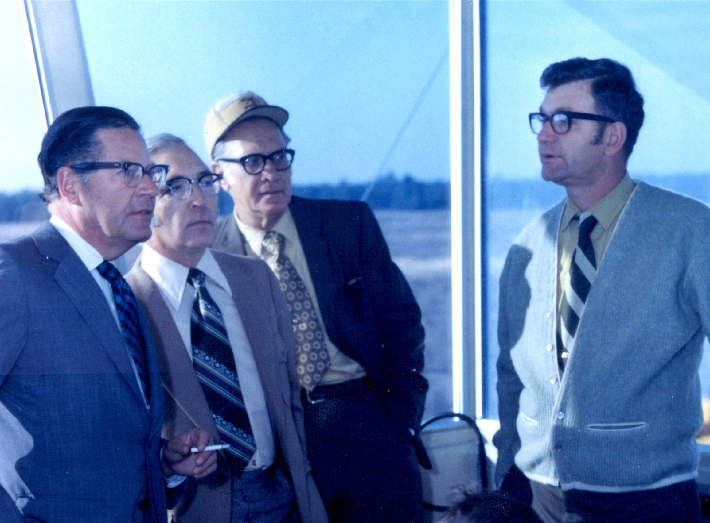 Randy Gilmore, right, demonstrates a tracking site's operation to executives of Vitro Corp. of America. The southern tip of Marco Island's beach spent years during the Cold War as a missile tracking station administered by the Air Force. Photo courtesy of Randy Gilmore