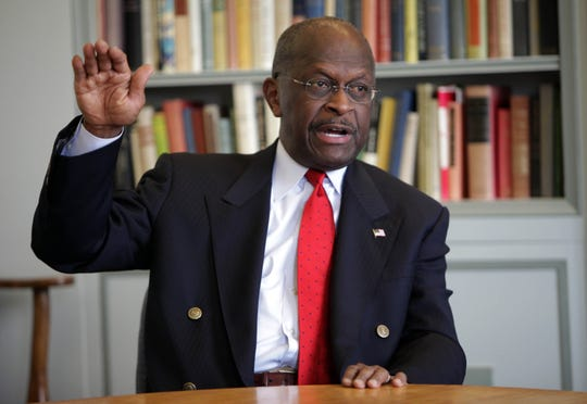Republican presidential candidate Herman Cain talks with the Milwaukee Journal Sentinel Editorial Board on on Monday, November 14, 2011.