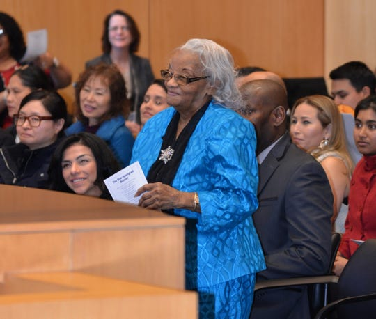 At a ceremony in New York, Uctorieuse Destin was so stunned to see her daughter from Milwaukee take the bench to administer the oath of citizenship that she remained standing after other candidates for naturalization sat down.