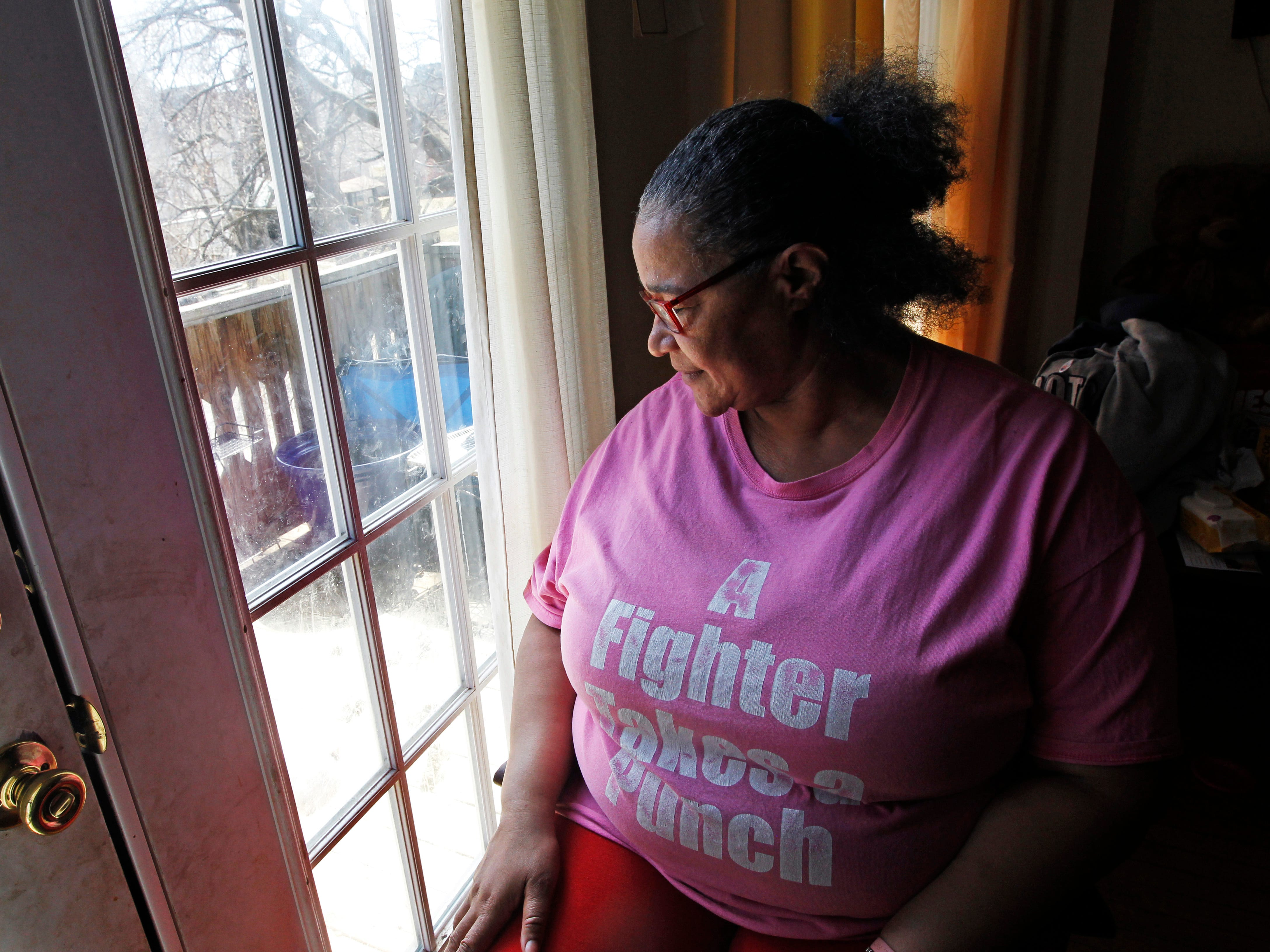 Tanja Dixon sits in her favorite chair at her home in Milwaukee. Her son, Anthony Daniels, was shot and killed Sept. 7, 2017.