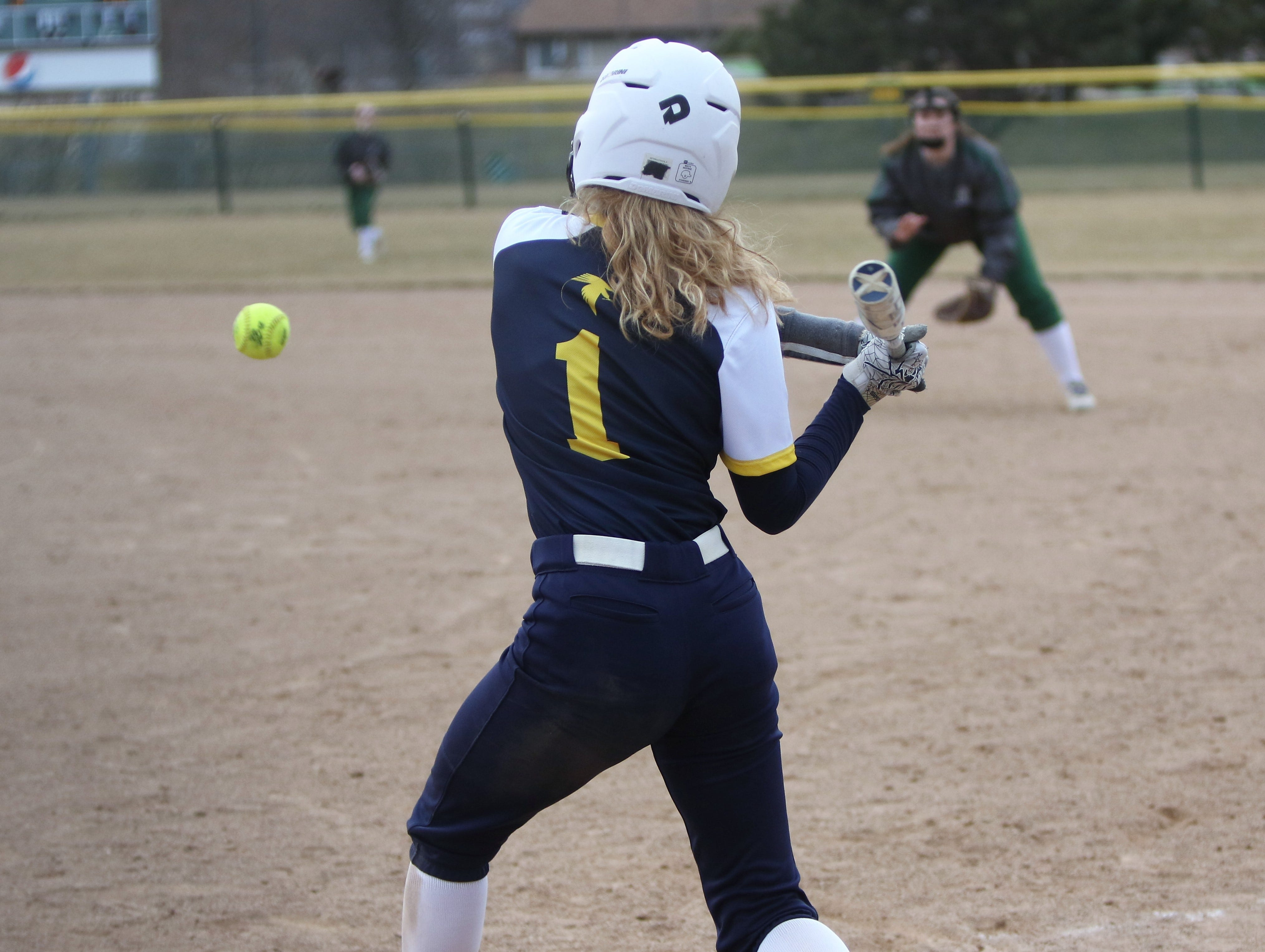 Whitnall junior Abby Cunningham swings en route to launching a home run against Greenfield on April 3, 2019.