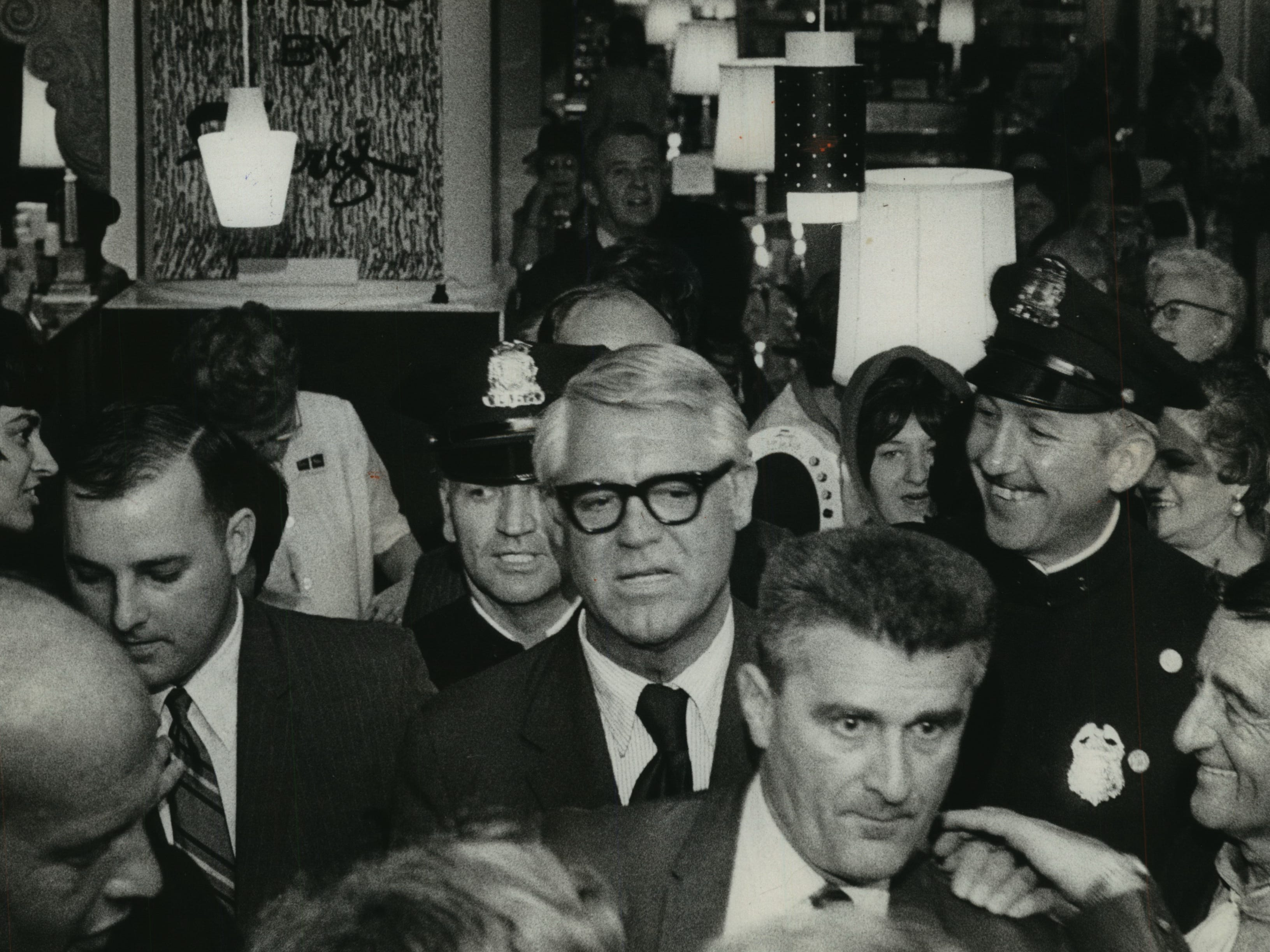 Cary Grant was swarmed by the crowd when he visited Milwaukee and the Downtown Boston Store, November 2, 1969.