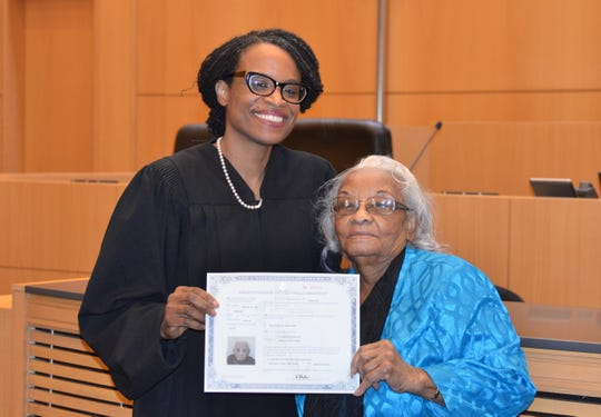 Federal Magistrate Judge Nancy Joseph and Uctorieuse Destin, the surrogate mother who raised her in Haiti, show off Destin's naturalization certificate. Joseph works in Milwaukee, but she traveled to New York to surprise her mom on March 28 by presiding over the ceremony when Destin became a citizen at age 92.