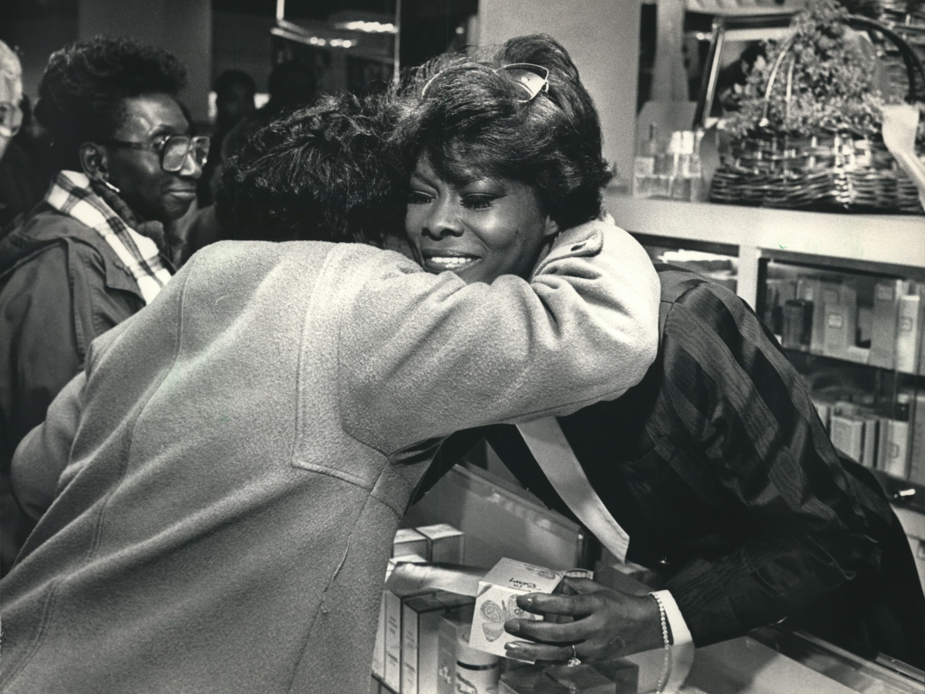 """Dionne Warwick was embraced by Sandy Stotts as the popular vocalist made a personal appearance to promote her new perfume, """"Dionne,"""" October 22, 1987, at Boston Store at the Grand Avenue retail center in Milwaukee. Warwick also performed with Burt Bacharach at the Riverside Theater."""