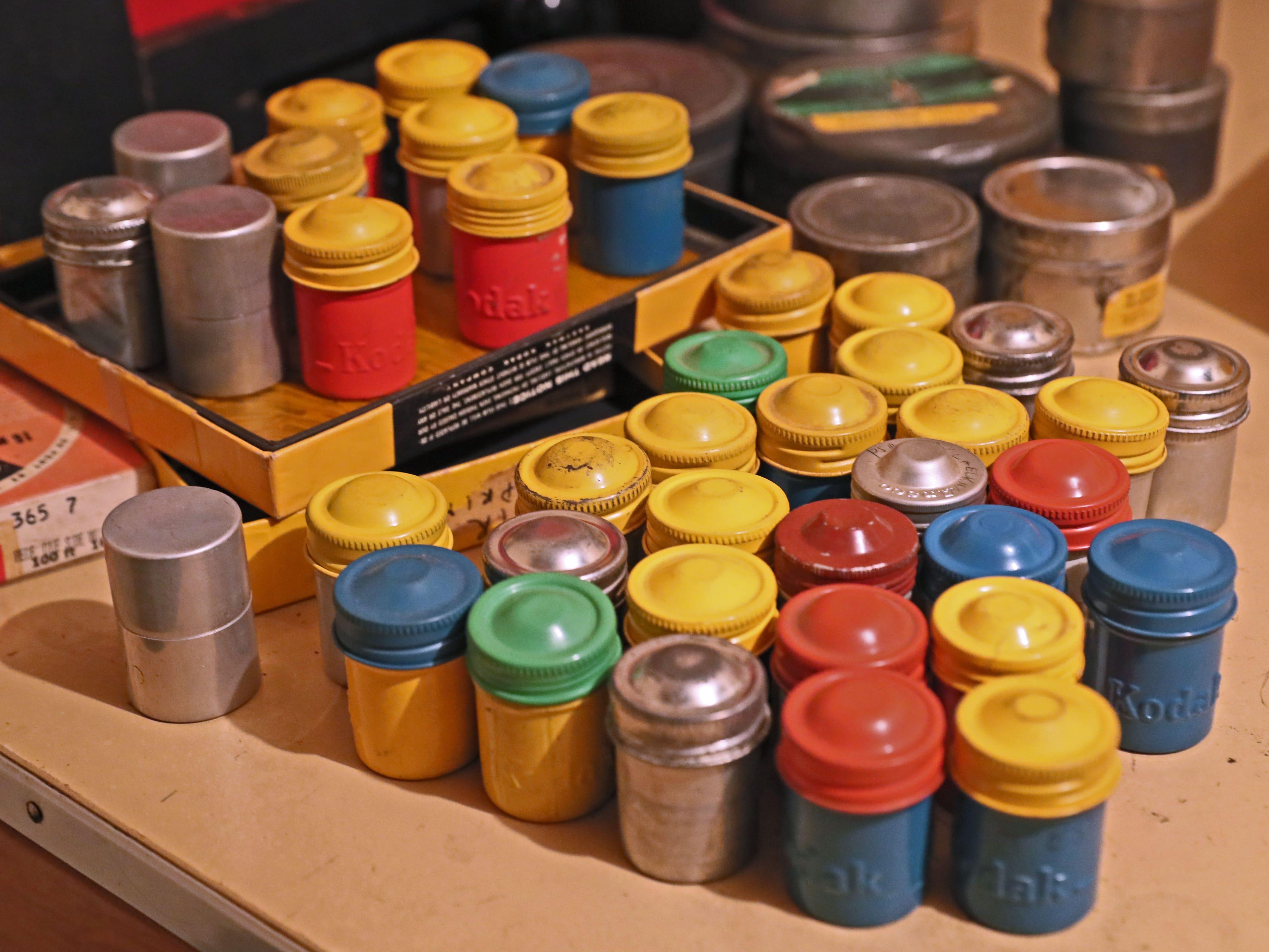 Metal film cans that 35mm film came in from Kodak sit in Jake Skocir's basement darkroom.