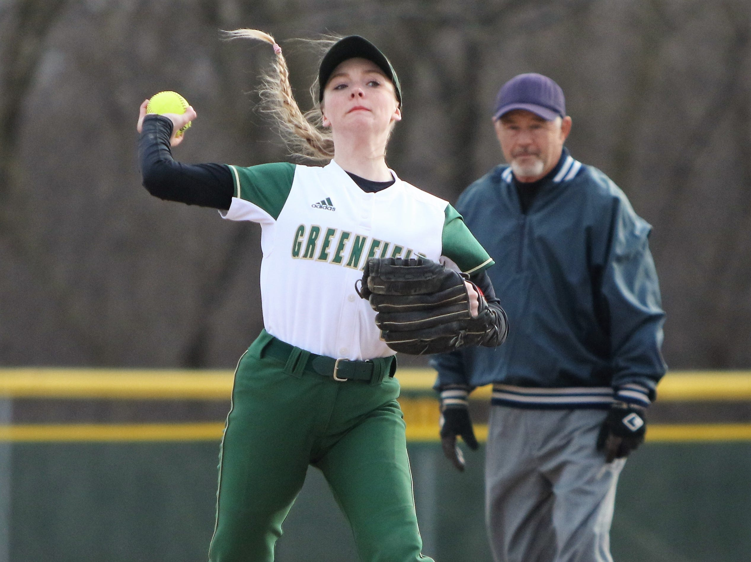 Greenfield shortstop Amanda Polachek throws to first base after fielding a grounder against Whitnall on April 3, 2019.