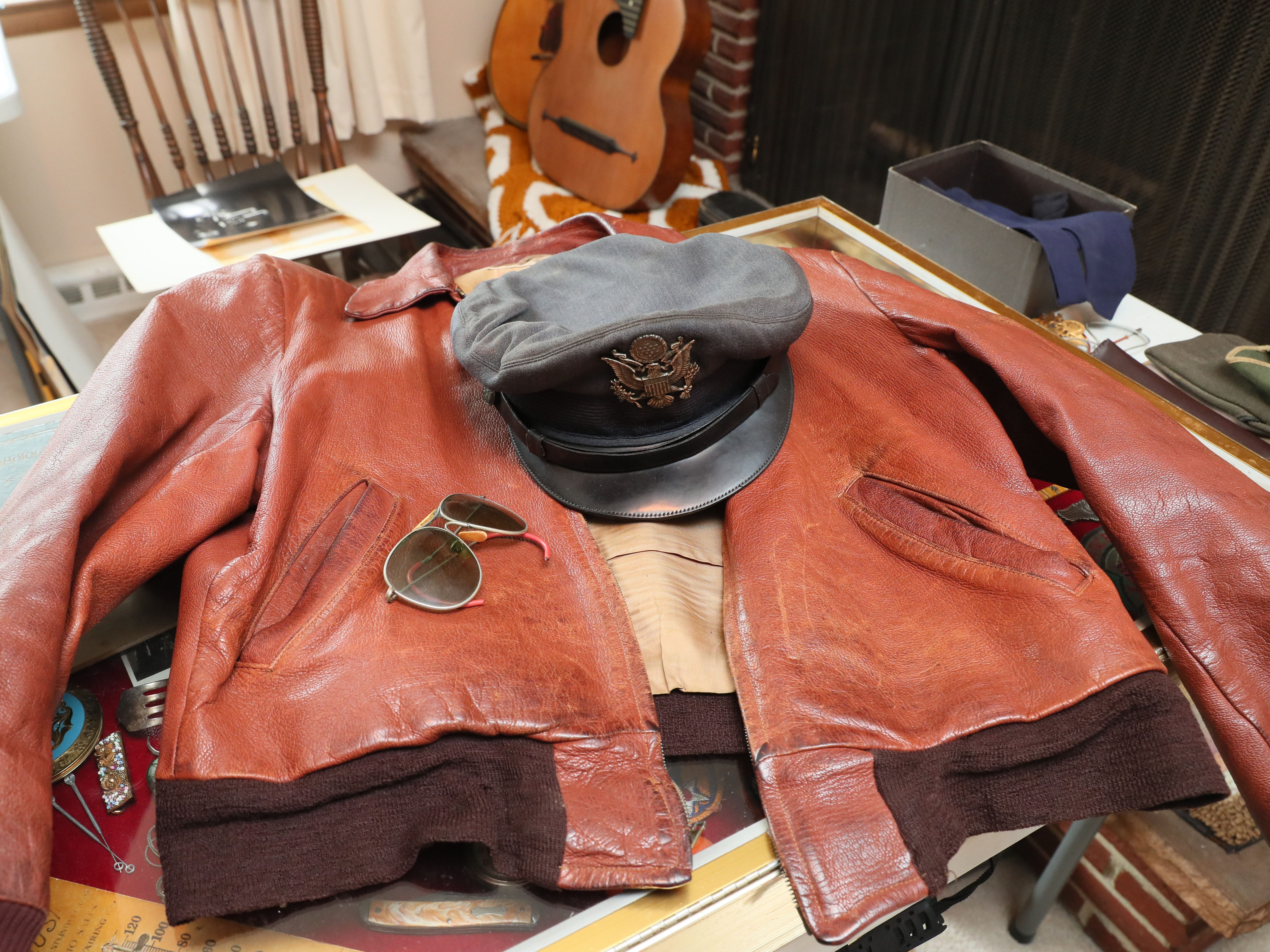 A World War II-style flight jacket is among the items being sorted through for the estate sale.