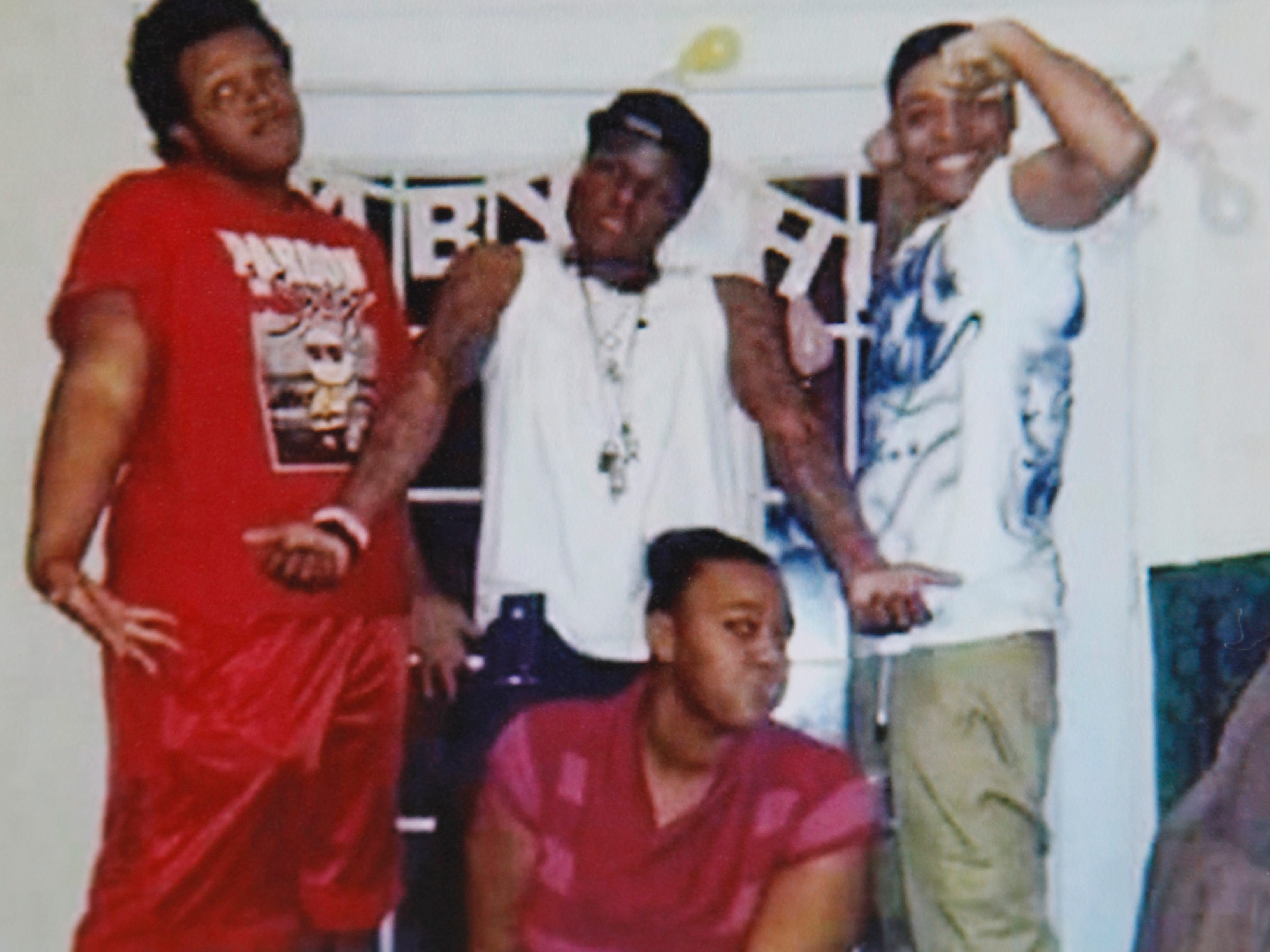 Anthony Daniels, 26, center, poses for a photo with his siblings, Adrian, left, Antwan, right, and Maggie, kneeling, in 2014.