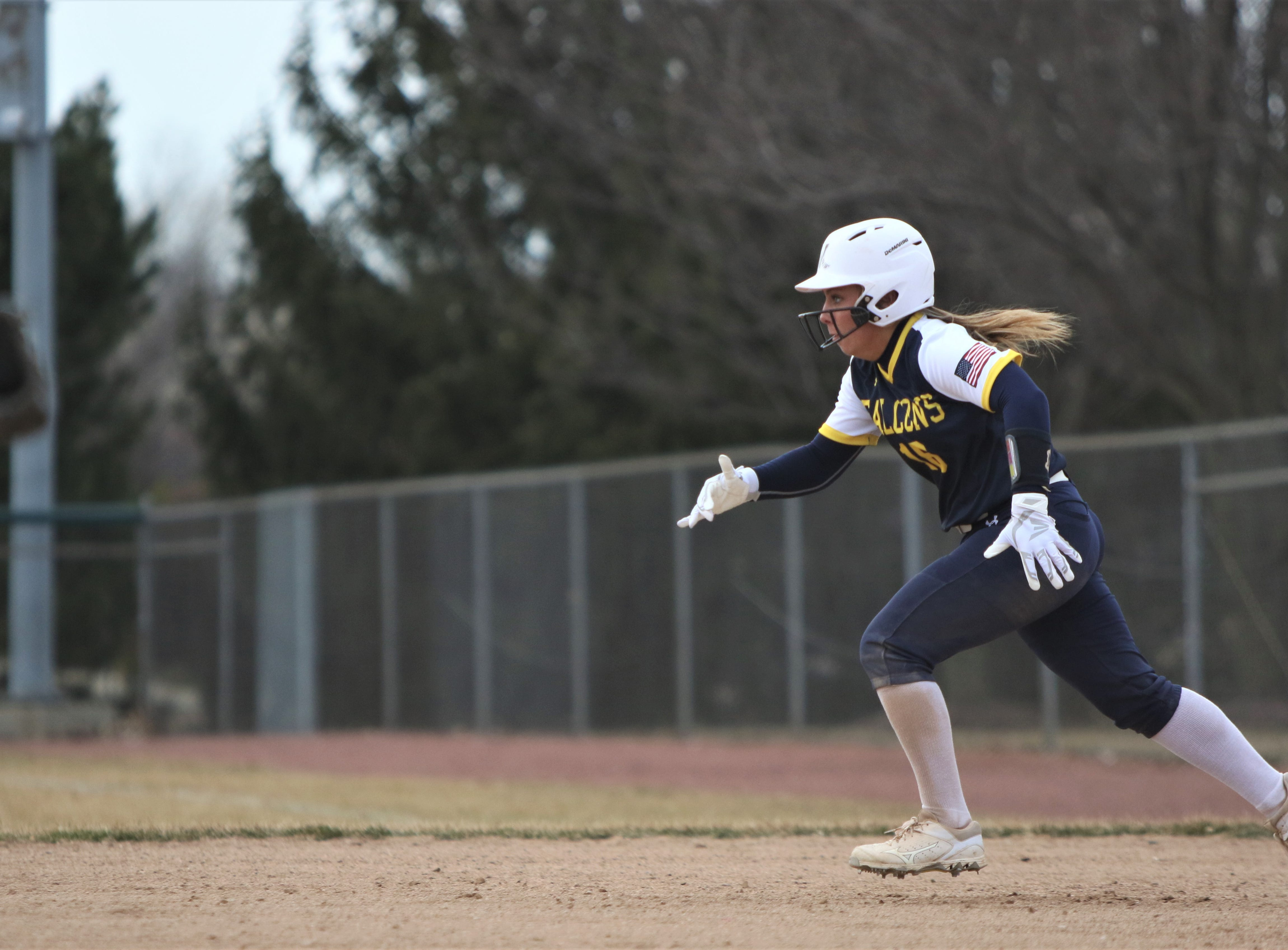 Whitnall senior Haley Wynn takes off toward second base for a stolen base during a season-opening game against Greenfield on April 3, 2019.