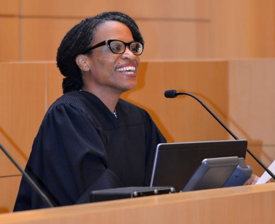 Her smile reveals the delight that Nancy Joseph, a federal magistrate judge assigned to Milwaukee, experienced when she was able to make a guest appearance in New York federal court and preside at the naturalization ceremony for her 92-year-old surrogate mother.
