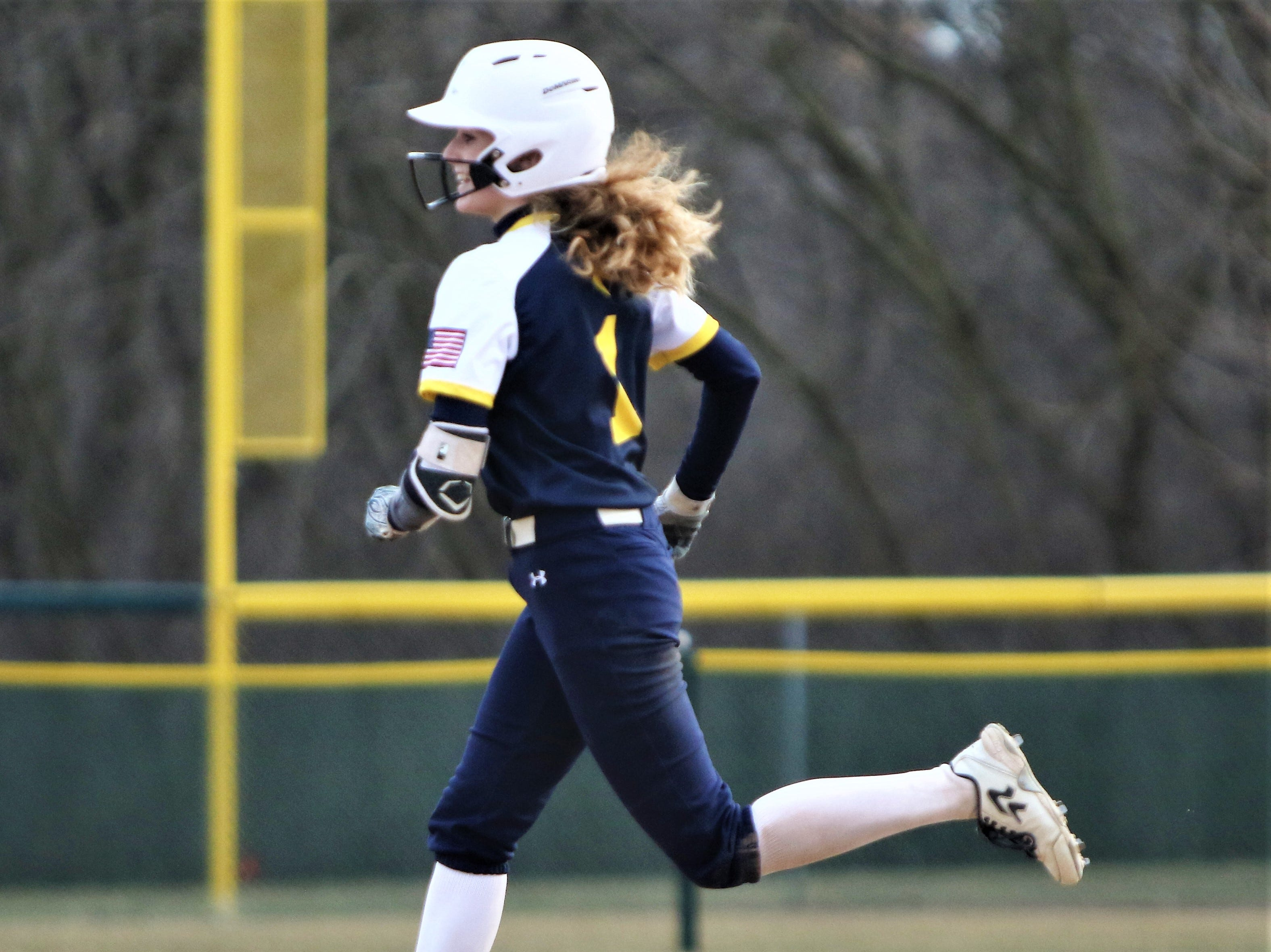 Whitnall junior Abby Cunningham rounds the bases after hitting a home run against Greenfield on April 3, 2019.