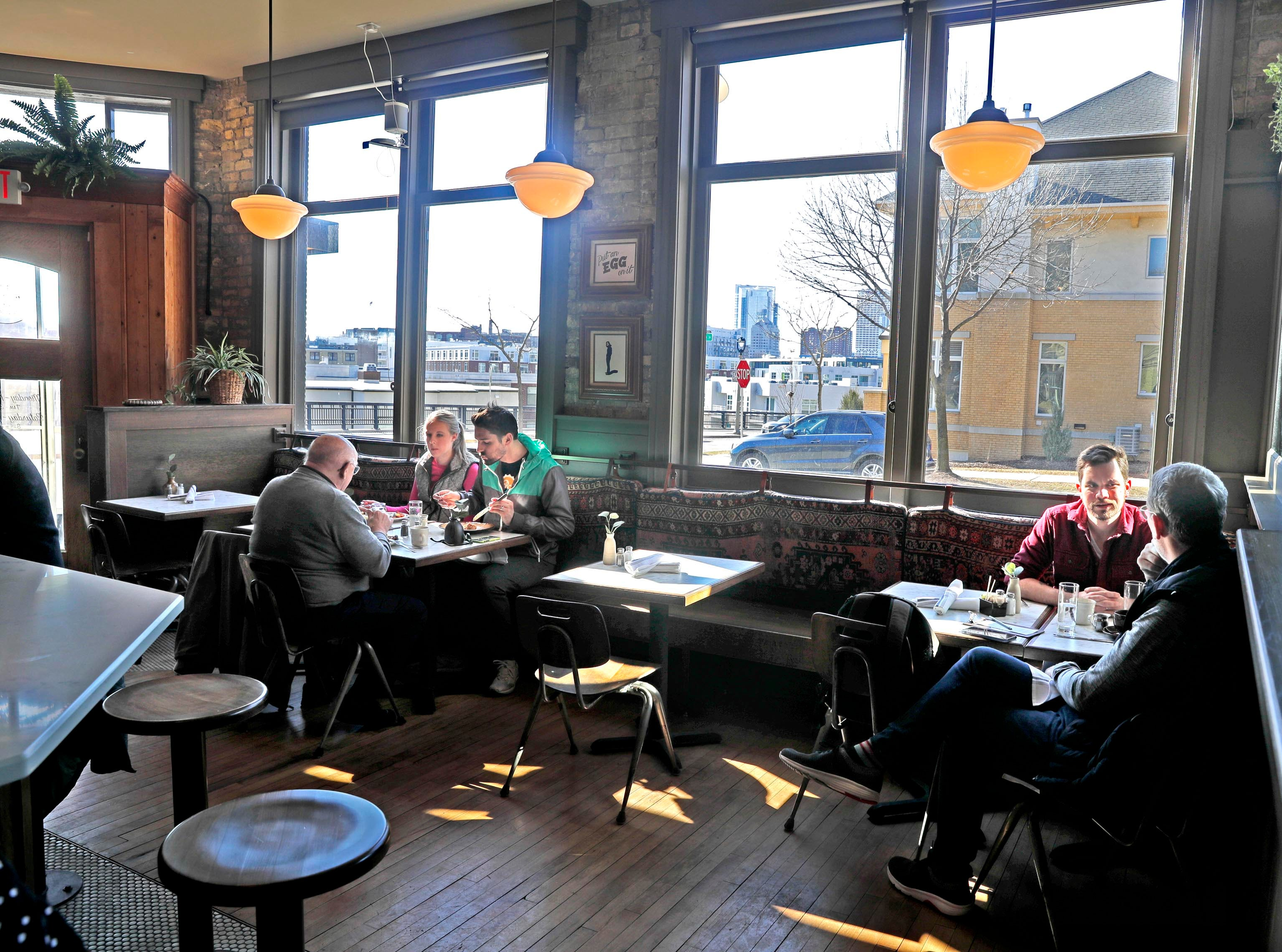 Some seats at Uncle Wolfie's Breakfast Tavern in Brewers Hill have a view of the downtown skyline. The restored Cream City brick building dates to 1902.